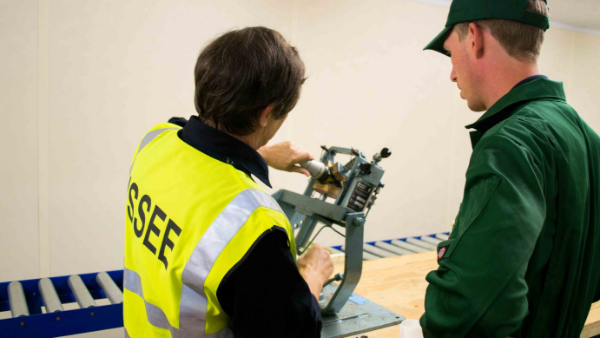 An ISSEE instructor does a demonstration for a student